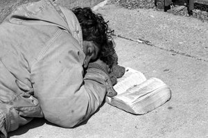 Heaven is my home: Homeless man sleeping with his bible