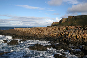 Giant's Causeway 4: Tourists exploring the hexagonal basalt columns of the Giant's Causeway, Northern Ireland.