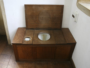 Ancient lavatory: A boxed lavatory in an old house in England.