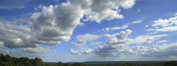 Surrey sky: View of summer cloud formations from Puttenham Common, Surrey, England. Three shot photomerge.