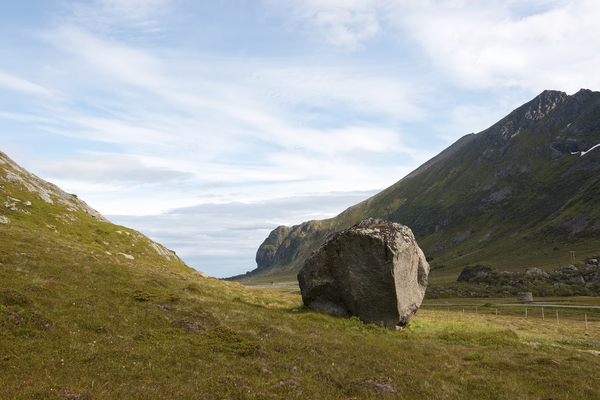 Boulder valley: A single large boulder on a hillside in the Lofoten Islands, Norway.