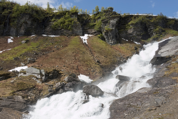 Waterfall: A waterfall fed by melting snow in Norway.
