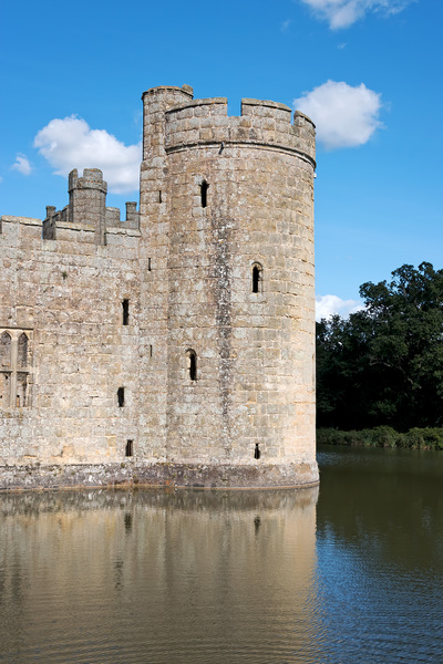 Castle turret and moat: Part of Bodiam Castle and moat in East Sussex, England. Photography of the exterior of this National Trust property was freely permitted.