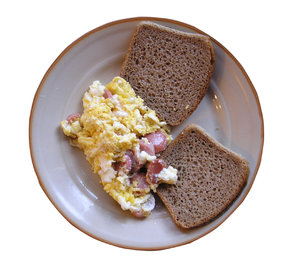 Scrambled eggs with bread: A three minutes breakfast.