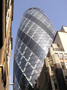 Gherkin: A wolrd famous building in London. 30 St Mary Axe also known as Swiss Re Building.