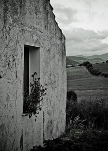 old house: I look at the window and the fields at sunset