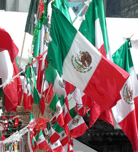 Mexican Flag: A shot of mexican flags sold at the Independence Day (September 15th).
