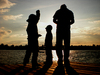 silhouettes on the lake: silhouettes of my family on our holiday in Burgenland (Austria)