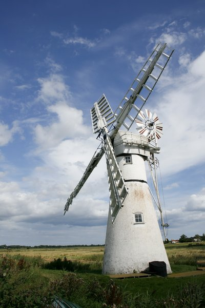 Norfolk windmill: Windmill in the Norfolk Broads, along the River Thurne. Windmills are part of the landscape of Norfolk and the windmill at Thurne is a classic example of the heritage of the area.