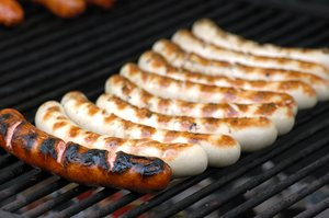 Sausages: sausages on a grill