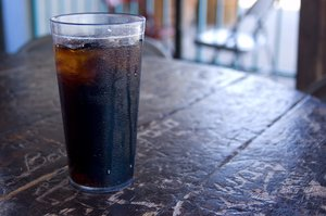 Enjoy A Coke: A condensating glass of pop.