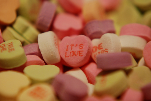 It's Love: Close up of a candy heart displaying the message, 'it's love'.