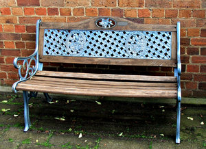 rosy seat: rose decorated wood and wrought iron bench seat