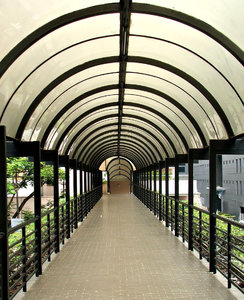 covered walkway: steel supported covered walkway providing sun and rain shelter