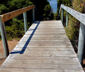 walking the planks1: wooden walkway and steep over the edge incline