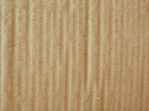 ribbed cardboard surface: brown ribbed cardboard sheet surface