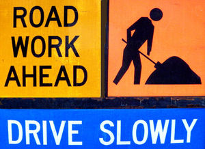 slow roadwork1: caution roadwork sign warning motorists to slow-down