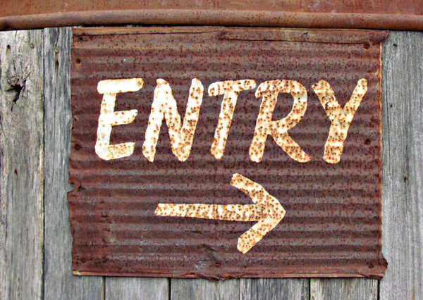 rusty sign1: rusty entry sign on old rustic wood