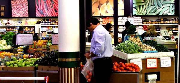 fruit & vegetable shopping: customers in a greengrocers store