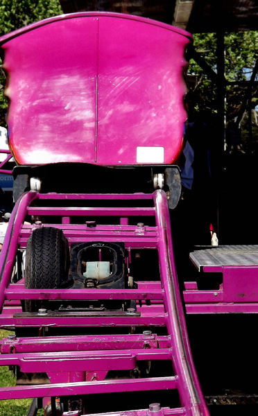 pink rail ride1: pink rails and carriage back at carnival - side show