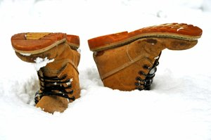 Snow Boots: A pair of brown boots after a heavy snowfall