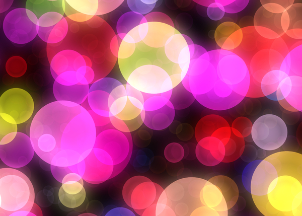 Bokeh or Blurred Lights 7: Bokeh, or blurred background lights in yellow, pink, blue, red, purple and white. Suitable for a background, Christmas greetings, holiday greetings, texture, or fill.