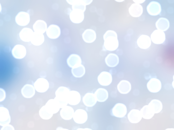 Bokeh or Blurred Lights 16: Bokeh, or blurred background lights inin blue and white. Suitable for a background, Christmas greetings, holiday greetings, texture, or fill.