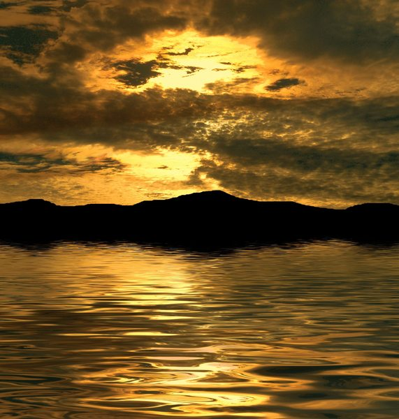 Lovely Sunset: A beautiful golden sunset over water. You may prefer:  http://www.rgbstock.com/photo/oFaYIji/Glory+3  or:  http://www.rgbstock.com/photo/nSytarO/Sunset+Over+Water