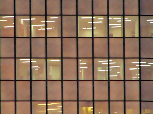 Building Facade: The exterior of a skyscraper in the early evening. You may prefer:  http://www.rgbstock.com/photo/n0WcMOm/Abstract+Cityscape+2  or:  http://www.rgbstock.com/photo/2dyX6Bd/City+Sillhouettes+With+Moon+3