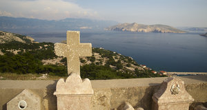 Graveyard on hilltop: Mediterranean graveyard on hilltop with excellent view to the sea, Baska, Croatia