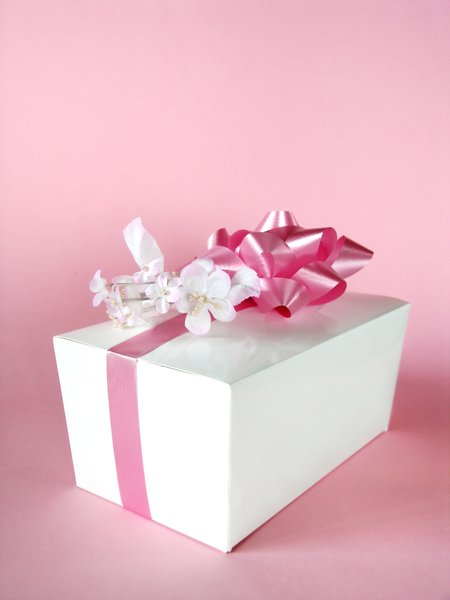 Pink gift: Candy gift box on pink background