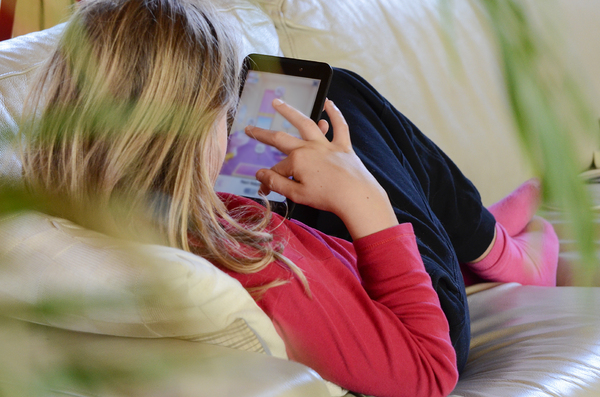 Chilling with a tablet: Child with a tablet