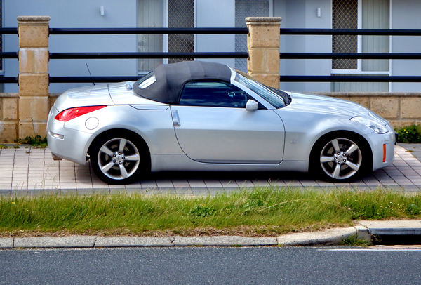 a sporty little number: convertible two-seater sports car