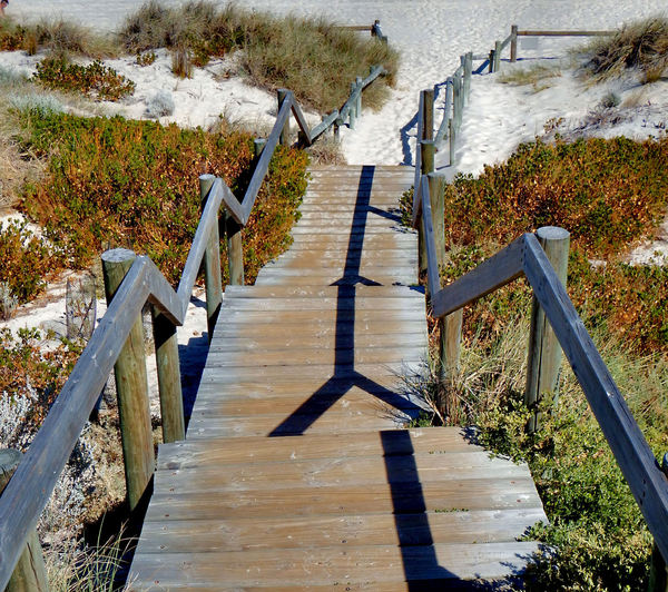 beach sand access1b: downward angled wooden walkway to sandy beach