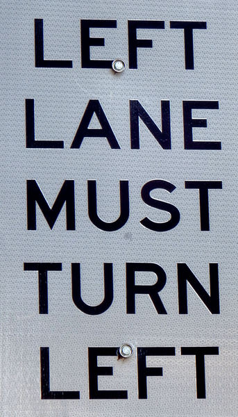 reflective left turn sign: reflective left turn vehicular traffic sign - only one way to go