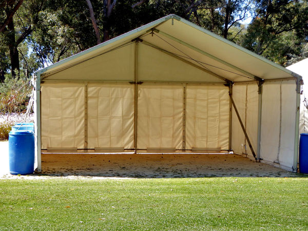 temporary tent1: erected park tent shelter in readiness for people programme