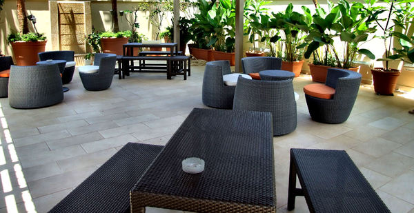rooftop patio1: black patio furniture in rooftop sheltered area