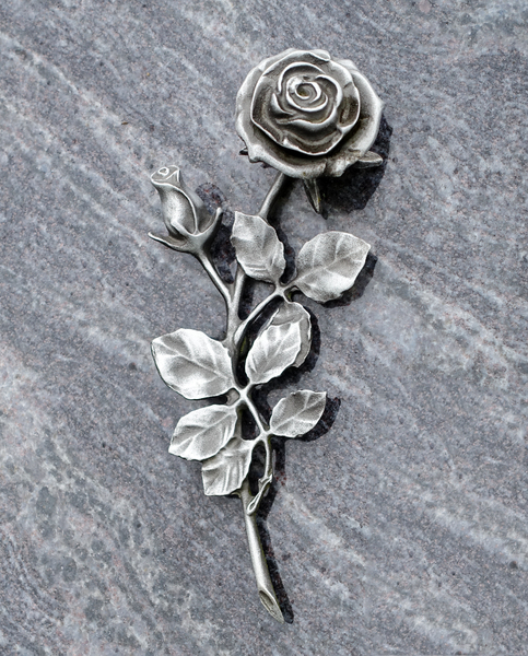 a silver rose on marble