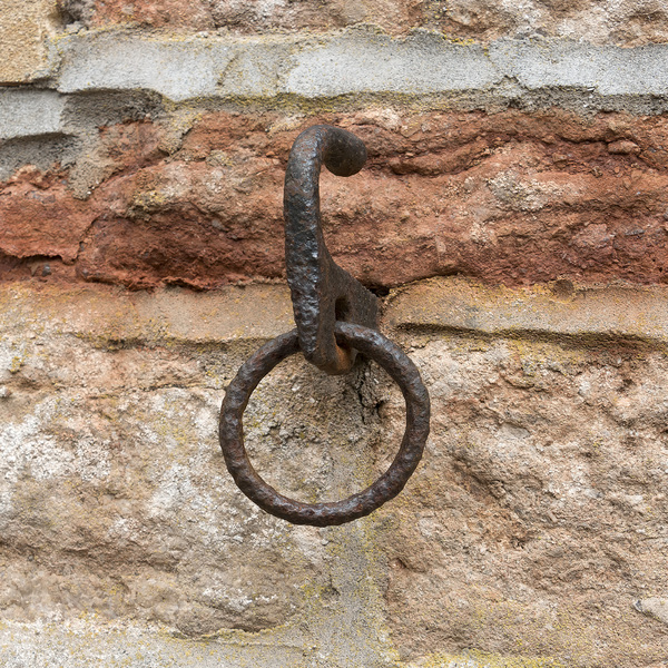 Old iron ring: An old rusted iron wall ring.