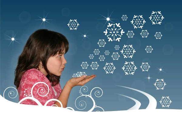 Girl blowing snowflakes: Girl ( my daughter) blowing snowflakes