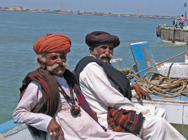 On the boat: Picture of two elder villagers on a boat