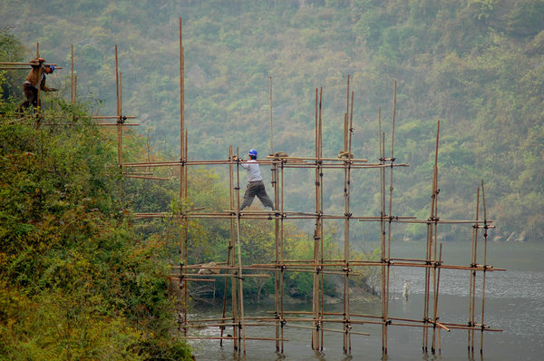 Bridge builders: Building a scaffold to build a new bridge over the Daning river (a tributary to the Yangtze river) in China.