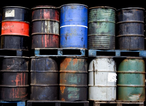 Oil Drums: Some battered and leaking oil drums on a trailer.  Pollution theme.