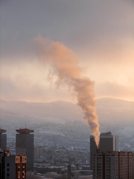 under a blood red sky: Winter morning in Sarajevo and the smoke from the heating company