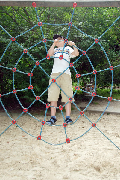 Boy in the net 1: Child by playing on the playgound