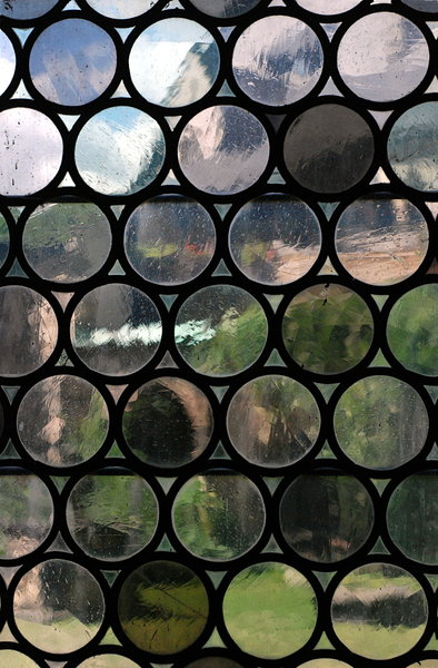 View trough medieval window, t: Stained-glass from middle ages, pattern