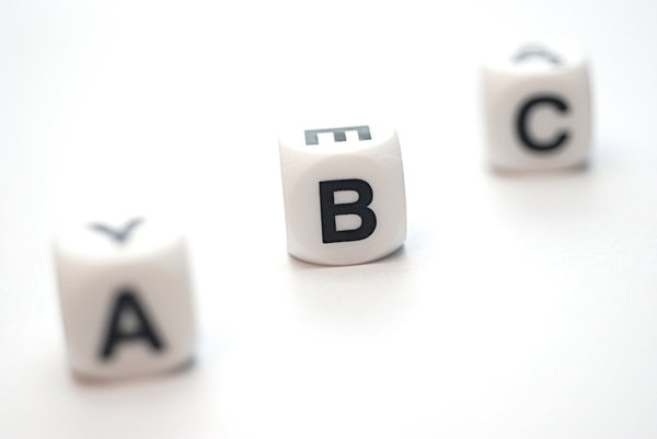 Letter B between others: Cubes with letters