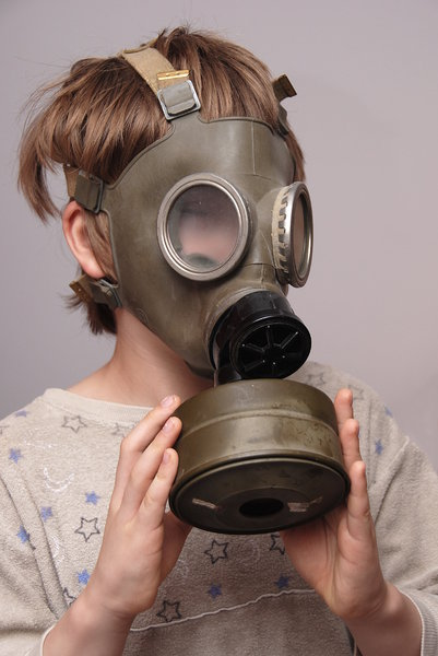 Boy in the soviet gas mask  4: Mask worn over the face to protect the wearer from inhaling airborne pollutants and toxic materials