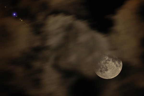 Moon between the clouds 1