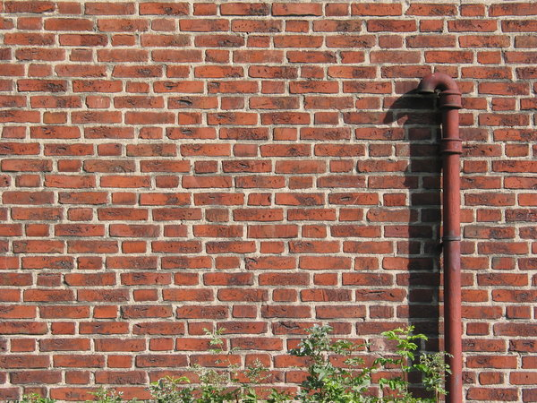 brickwall and pipe: brickwall and pipe captured in Lund, Sweden.